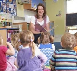 rp_48849383-group-of-pre-school-children-listening-to-teacher-reading-story.jpg